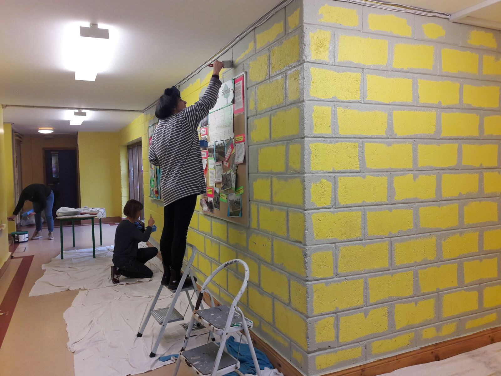 Painting Parents Banish Yellow Brick Walls.👍