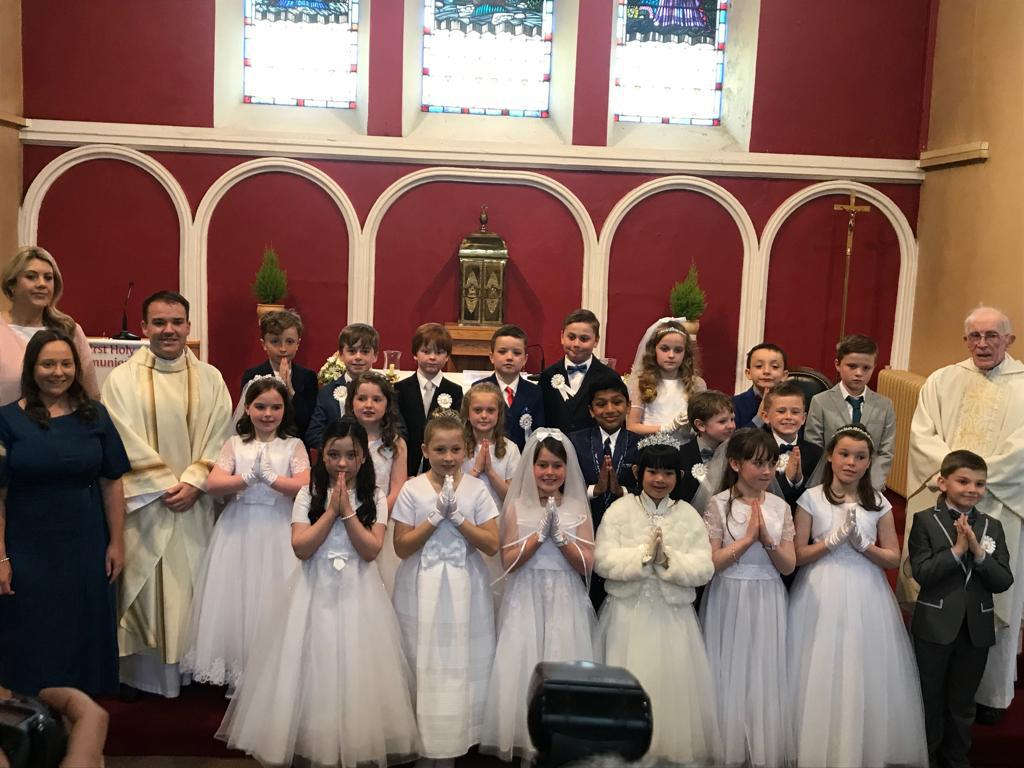 Second Class Receive  Their  First Holy Communion.